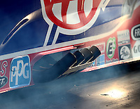 Oct 14, 2016; Ennis, TX, USA; Detailed view of the header exhaust pipes on the car of NHRA funny car driver Robert Hight during qualifying for the Fall Nationals at Texas Motorplex. Mandatory Credit: Mark J. Rebilas-USA TODAY Sports