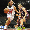 Zoey Quinn #25 of MacArthur, left, gets pressured by Maxine Bresnaider #21 of Mepham during a Nassau varsity girls basketball game against Mepham at NYCB Live's Nassau Coliseum in Uniondale on Saturday, Dec. 23, 2017. Mepham won by a score of 45-40.