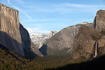 """The Valley"" The entrance of Yosemite National Park's valley floor with El Capitan on the left, Half Dome in the middle and Bridalveil Waterfall on the right at sunset.  I was in Yosemite for a week in March and a week in April during the Spring of 2013. Due to the light winter snow fall I went earlier than normal to capture the waterfalls while they were still flowing pretty good. Sunsets in Yosemite really bring out the spectacular colors of the rock formations."