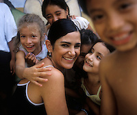 Lydia Cacho, director of a crisis center in Cancún for women and children who have been victims of violence, with some of her clients. She has been receiving death threats for eight years but is undaunted. May 25, 2005.  Cancun, Mexico.