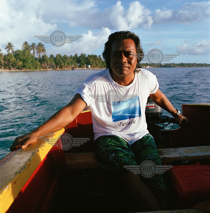 Kalisi Sogivalu, finance director of Telecom Tuvalu takes a boat out on the lagoon to go fishing.