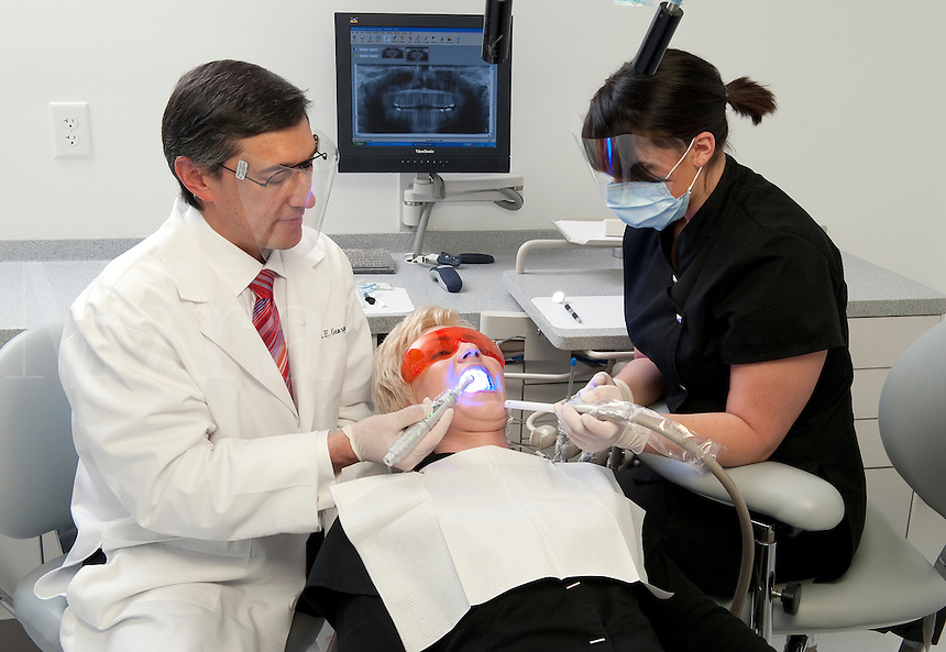 Dentist and assistent work on a patient.