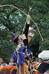 August 17th, 2011- Mishima, Shizuoka, Japan- A Yabusame rider points a ceremonial arrow to the heavens during an opening ceremony at the start of a Yabusame shinto ritual at Mishima Taisha Shrine.