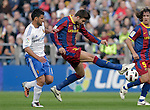 FC Barcelona's Gerard Pique (r) and Real Zaragoza's Braulio Nobrega during La Liga match.October 23,2010. (ALTERPHOTOS/Acero)
