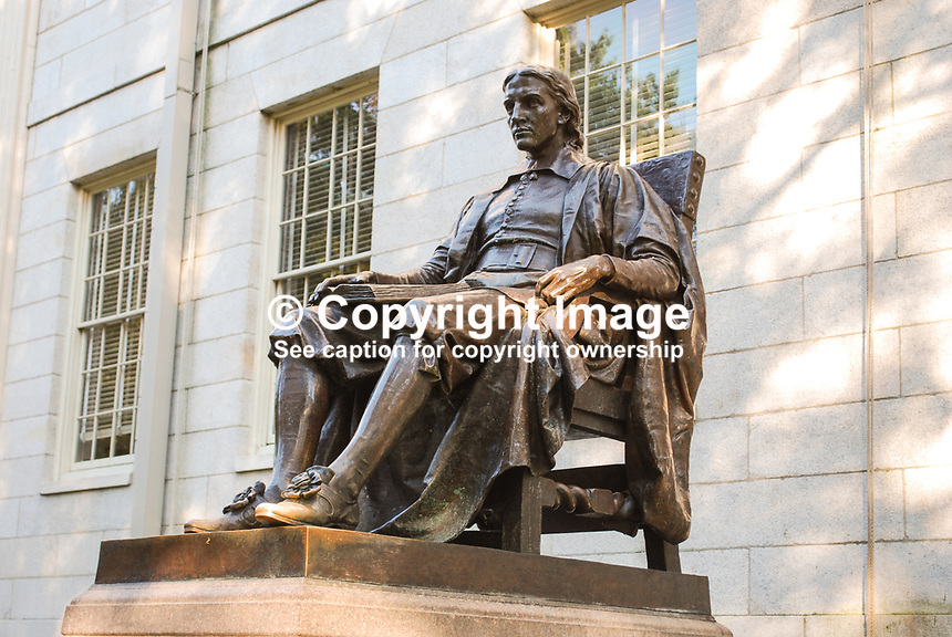 John Harvard Statue at Harvard University, Boston, Massaschussets, USA.  It is also known as the Statue of Three Lies. The face is fictional as no original picture or statue of him survives. He was not the founder but the university's bit its first benefactor. The inscription says Harvard was founded in 1638; it was actually founded two years earlier. 201110074953..Copyright Image from Victor Patterson, 54 Dorchester Park, Belfast, United Kingdom, UK...For my Terms and Conditions of Use go to http://www.victorpatterson.com/Victor_Patterson/Terms_%26_Conditions.html