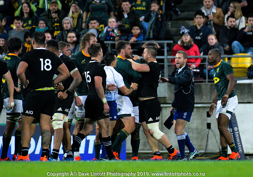 Dane Coles gets to grips with Frans Steyn during the Rugby Championship rugby union match between the New Zealand All Blacks and South Africa Springboks at Westpac Stadium in Wellington, New Zealand on Saturday, 27 July 2019. Photo: Dave Lintott / lintottphoto.co.nz