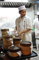 The kitchen of Mak Pui Gor,50, (green shirt)  in Tim Ho Wan the cheapest Michelin starred restaurant in the world, Hong Kong..17-Jul-11..Photo by Richard Jones....