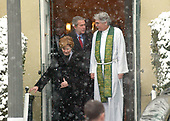 United States President George W. Bush and first lady Laura Bush, depart Saint John's Church with pastor Louis Leon, right, Sunday, January 30, 2005, in Washington, D.C.  Bush is forgoing his usual weekend getaway at the Camp David presidential retreat to remain at the White House to monitor election results and the violence in Iraq.<br /> Credit: Greg E. Mathieson / Pool via CNP