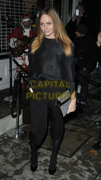 Stella McCartney.The Stella McCartney Store Christmas Lights switch on show, Stella McCartney boutique, Bruton St., London, England..November 29th, 2011.full length black top trousers grey gray cropped tights hand in pocket clutch bag ribbon bows .CAP/CAN.©Can Nguyen/Capital Pictures.