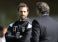 2008/09 Phoenix captain Andrew Durante talks to Phoenix CEO Tony Pignata during the Wellington Phoenix A-League football training session Training Session at Newtown Park, Wellington, New Zealand on Monday, 4 May 2009. Photo: Dave Lintott / lintottphoto.co.nz