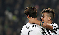 Juventus' Paulo Dybala, right, celebrates with teammate Sami Khedira after scoring during the Italian Serie A football match between Juventus and Roma at Juventus Stadium.