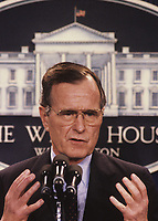 ***FILE PHOTO*** George H.W. Bush Has Passed Away<br /> Washington DC., USA,  1990<br /> President George H.W. Bush. Answers reporters question during news conference in the White House press briefing room. <br /> CAP/MPI/MRN<br /> &copy;MRN/MPI/Capital Pictures