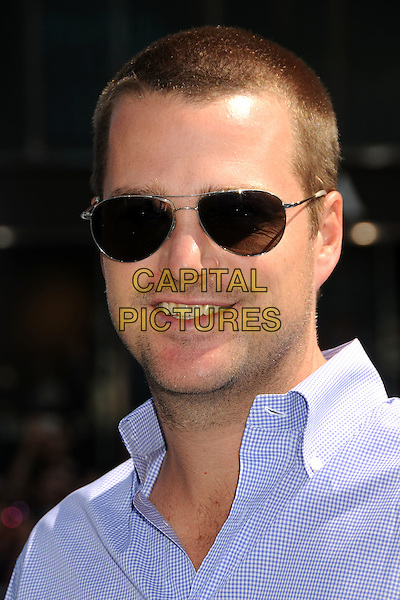 "CHRIS O'DONNELL .""Cats & Dogs: The Revenge of Kitty Galore"" Los Angeles Premiere held at Grauman's Chinese Theatre, Hollywood, California, USA, 25th July 2010. .portrait headshot sunglasses blue shirt smiling .CAP/ADM/BP.©Byron Purvis/AdMedia/Capital Pictures."