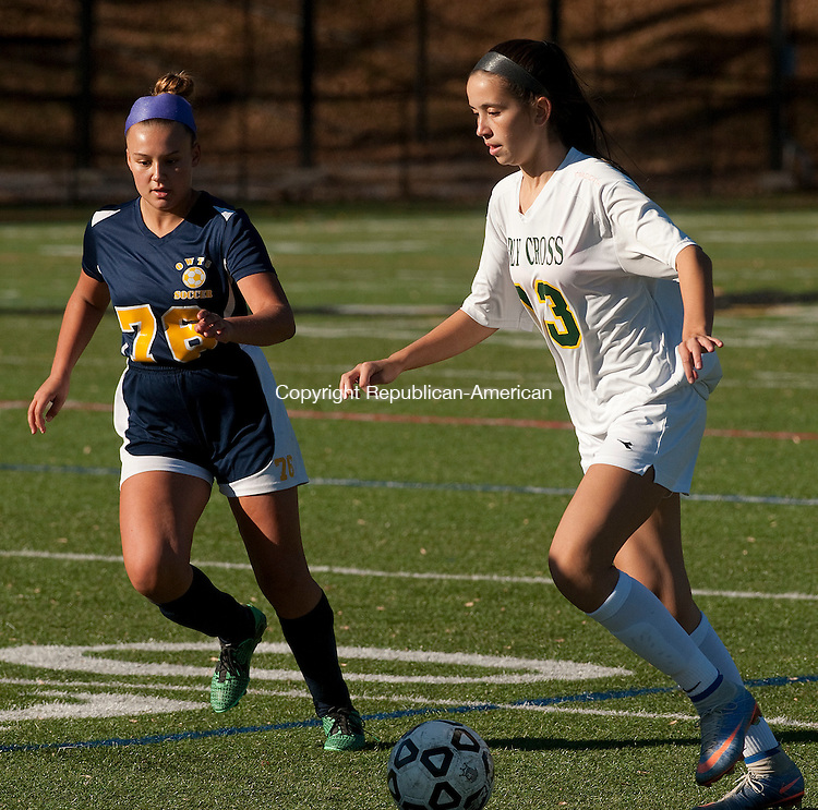 WATERBURY,  CT-110716JS06- Holy Cross' Adelisse Padilla (13) slips past Wolcott Tech's Sierra McIlwain (76) during their first round Class S tournament game Monday at Post University in Waterbury. <br /> Jim Shannon Republican American