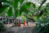 Oct. 14, 2016 - Don Sahong, Laos. Monks walk through a village to collect alms in the early morning. © Nicolas Axelrod / Ruom