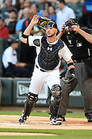 Chicago White Sox catcher Tyler Flowers (21) looks for the ball on a hit during a game against the Toronto Blue Jays on August 15, 2014 at U.S. Cellular Field in Chicago, Illinois.  Chicago defeated Toronto 11-5.  (Mike Janes/Four Seam Images)