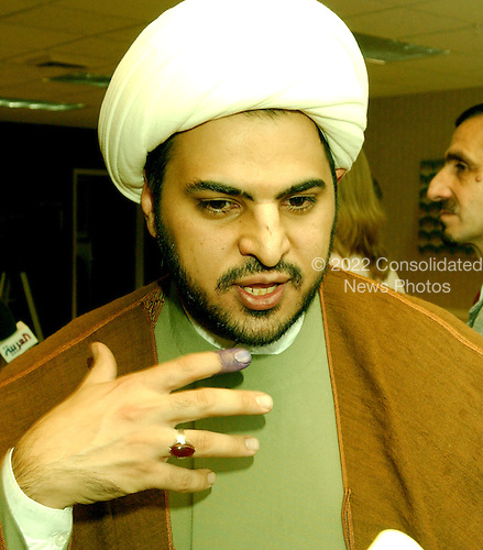 McLean, VA - December 13, 2005 -- Imam Maan Al Sahlani, who emigrated to Jamaica, Queens, New York from Basra, Iraq, is interviewed by a reporter inside the polling place for the Iraqi election in McLean, Virginia on December 13, 2005.  Imam Al Sahlani is affiliated with the Al Khoei Benevolent Foundation in New York, New York.  Al Sahlani, a shiite cleric, fled Iraq in 1999 after seven uncles and four cousins were killed by Saddam Hussein's henchmen.  He was warned that he was next to die..Credit: Ron Sachs / CNP.(RESTRICTION: NO New York or New Jersey Newspapers or newspapers within a 75 mile radius of New York City)