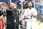Real Madrid's coach Zinedine Zidane (l) and Karim Benzema during La Liga match. September 14,2019. (ALTERPHOTOS/Acero)