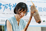Japanese actress and singer Hikari Mitsushima uses a stone axe to construct a wooden dugout canoe during a news conference at the National Museum of Nature and Science in Tokyo on July 31, 2018, Tokyo, Japan. The museum aims to collect 30 million yen to recreate the Japanese ancestors' journey between Taiwan and Yonaguni Island on a wooden dugout canoe. (Photo by Rodrigo Reyes Marin/AFLO)