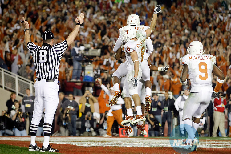 07 JAN 2010:  Teammates congratulate Dan Buckner (4) of the University of Texas on his 2-point conversion against the University of Alabama during the BCS National Championship held at the Rose Bowl in Pasadena, CA.  Alabama defeated Texas 37-21 for the national title. Jamie Schwaberow/NCAA Photos