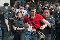 Moscow, Russia, 31/05/2010..Police arrest a journalist wearing a police issued press card as they break up an opposition protest in central Moscow and arrest around 170 people. Opposition activists hold regular demonstrations on the 31st day of the month, protesting against restrictions on the freedom of assembly, which is protected by article number 31 of the Russian constitution.