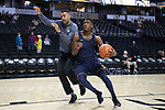 WINSTON-SALEM, NC - FEBRUARY 24: Notre Dame's Temple TJ Gibbs (right) and assistant coach Ryan Ayers (left). The Wake Forest University Demon Deacons hosted the University of Notre Dame Fighting Irish on February 24, 2018 at Lawrence Joel Veterans Memorial Coliseum in Winston-Salem, NC in a Division I men's college basketball game. Notre Dame won the game 76-71.