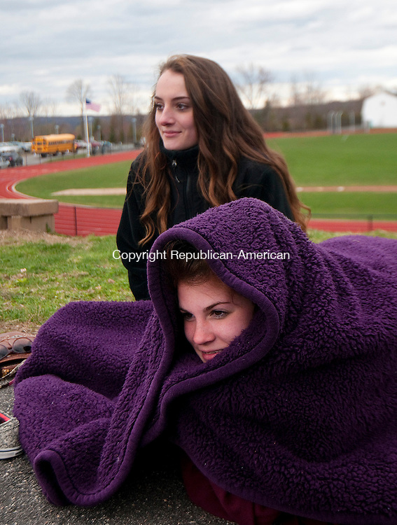 PLYMOUTH, CT--042715JS07- Terryville High School students, Seneca Ouellette, 18, left and Monica Oakes, 17, right, bundle up from the wind and cool temperatures while watching the baseball between Terryville and Thomaston Monday at Terryville High School.<br /> Jim Shannon Republican-American