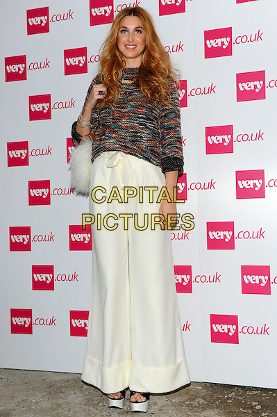 Whitney Port  .The Very.co.uk Fashion Preview for Spring and Summer 2012, Mercer Studios, London, England..September 20th, 2011.full length black green orange knitted jumper sweater top white cream wide leg flared trousers bag  .CAP/CJ.©Chris Joseph/Capital Pictures.