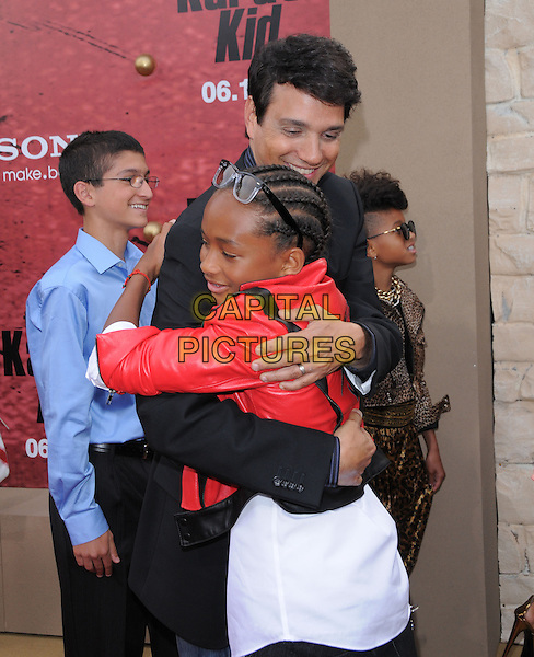 RALPH MACCHIO & JADEN SMITH.L.A. Premiere of The Karate Kid held at The Mann Village Theatre in Westwood, California, USA..June 7th, 2010 .half length suit jacket red leather white hug embrace blue black.CAP/RKE/DVS.©DVS/RockinExposures/Capital Pictures.