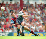 Denis Irwin of Manchester Utd -challenges Savo Milosevic of Aston Villa  Barclays Premier League - Aston Villa v Manchester Utd - Villa Park Stadium - Birmingham - England - 19th August 1995 - Picture Sportimage