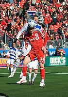 11 April 2009:  Toronto FC midfielder Carl Robinson #33 and FC Dallas forward Kenny Cooper #33 battle for a ball in front of the Toronto goal during an MLS game at BMO Field in Toronto between FC Dallas and Toronto FC. The game ended in a 1-1 draw.