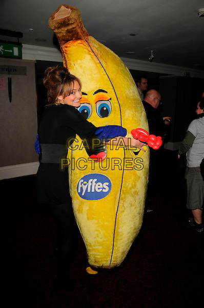 KARA TOINTON.At the Mad Hatters Tea Party, Grosvenor House Hotel, Park Lane, London, England, January 20th 2008..full length black dress banana hugging funny.CAP/CAN.©Can Nguyen/Capital Pictures