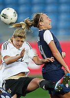 USA's Whitney Engen fights for the ball with Germany's Luisa Wensing during their Algarve Women's Cup soccer match at Algarve stadium in Faro, March 13, 2013.  .