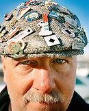 USA, Utah, skier wearing a hat covered in ski pins, Deer Valley Ski Resort