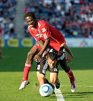 Chicago Fire forward Patrick Nyarko (14) collides with DC United defender Jed Zayner (12).  The Chicago Fire tied DC United 0-0 at Toyota Park in Bridgeview, IL on Oct. 16, 2010.