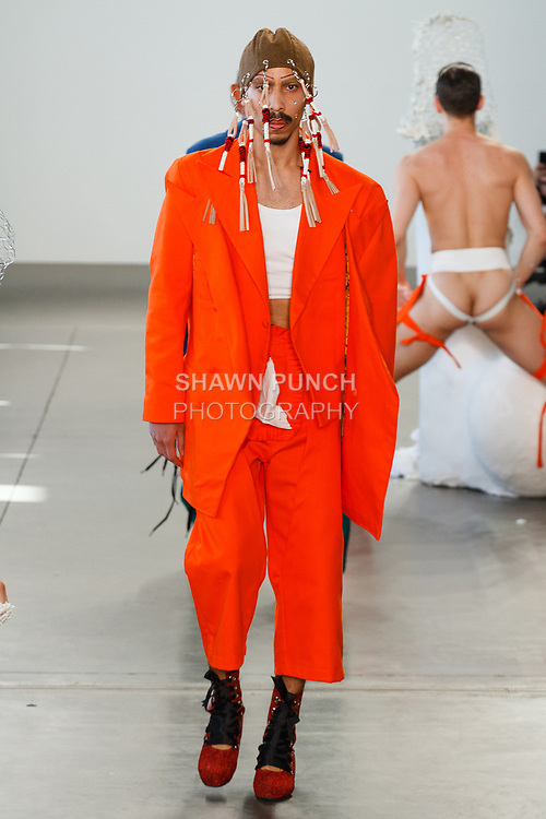 "Model walks runway in an outfit from the Sanchez-Kane Autumn Winter 2018 ""Artesanal Sex Shop"" collection by Barbara Sanchez Kane, at Pier59 Studios in New York City, on February 5, 2018; during New York Fashion Week: Men's Fall Winter 2018."