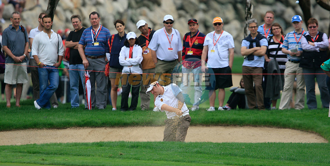 Louis Oosthuizen plays his 2nd shot from a fairway bunker on the 11th hole during Day 2 Friday of the Abu Dhabi HSBC Golf Championship, 21st January 2011..(Picture Eoin Clarke/www.golffile.ie)