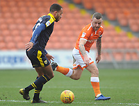 Blackpool's Jay Spearing vies for possession with Oxford United's Jordan Graham<br /> <br /> Photographer Kevin Barnes/CameraSport<br /> <br /> The EFL Sky Bet League One - Blackpool v Oxford United - Saturday 23rd February 2019 - Bloomfield Road - Blackpool<br /> <br /> World Copyright © 2019 CameraSport. All rights reserved. 43 Linden Ave. Countesthorpe. Leicester. England. LE8 5PG - Tel: +44 (0) 116 277 4147 - admin@camerasport.com - www.camerasport.com