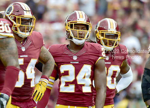 Washington Redskins cornerback Josh Norman (24) waits for the Cleveland Browns offense to come to the line during first quarter action at FedEx Field in Landover, Maryland on October 2, 2016.  Pictured with Norman are Washington Redskins inside linebacker Mason Foster (54) and strong safety David Bruton (30).  The Redskins won the game 31 - 20.<br /> Credit: Ron Sachs / CNP
