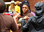 Britney Christian listens to other students she met during the Summer Bridge Program at Harris-Stowe State University in St. Louis during freshman move-in day on Wednesday August 15, 2018.    Photo by Tim Vizer