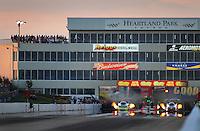 May 29, 2009; Topeka, KS, USA: NHRA funny car driver Dan Wilkerson (left) races alongside Jack Wyatt during qualifying for the Summer Nationals at Heartland Park Topeka. Mandatory Credit: Mark J. Rebilas-