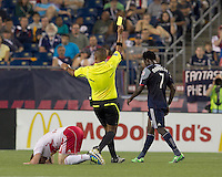 Yellow card for New England Revolution forward Kenny Mansally (7). In a Major League Soccer (MLS) match, the New England Revolution tied New York Red Bulls, 2-2, at Gillette Stadium on August 20, 2011.