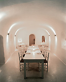GREECE, Santorini, Oia, a dining room by the pool at the Kirini Hotel in Oia