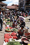 Women selling tomatoes and green beans at the Analakely market in Antananarivo in Madagascar