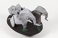 Origami elephant herd folded by Talo Kawasaki. Large elephant designed by Kunihiko Kasahara. Small elephants designed by Fumiaki Kawahata.