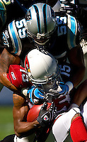Carolina Panthers linebacker Donte' Curry (55) tackles an Arizona Cardinals player during an NFL football game at Bank of America Stadium in Charlotte, NC.