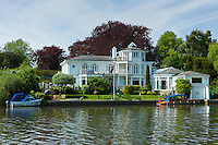 Luxury riverside houses on the banks of the River Thames in Berkshire,  UK