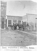 Horse and buggy stopped in front of Schulter &amp; Spengel hardware store in Gunnison.<br /> Gunnison, CO