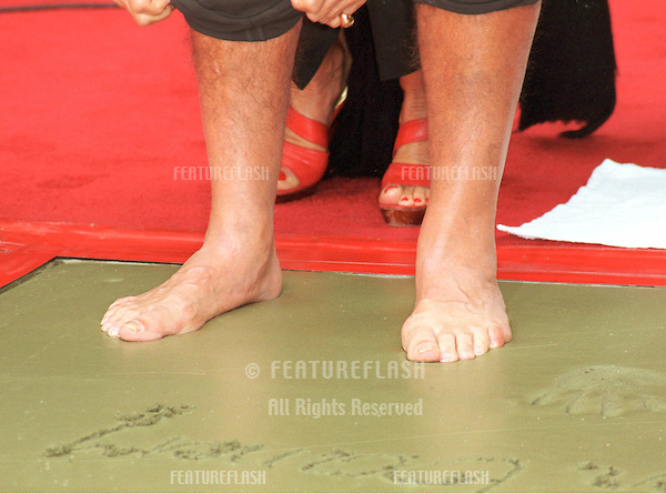 "13APR99:  Actor SEAN CONNERY at Hollywood's Manns Chinese Theatre where he had his hand & footprints set in cement. .His new movie, ""Entrapment,"" in which he stars with .Catherine Zeta Jones opens this week.    .© Paul Smith/Featureflash"