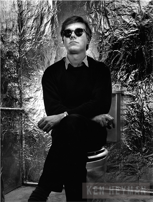 Andy Warhol sitting on his throne.